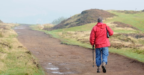 man-walking-on-a-hill-480x250